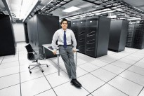 Portrait of a businessman inside a server room.