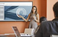 Businesswoman Presenting Budget Chart on Dell 70 Conference Room